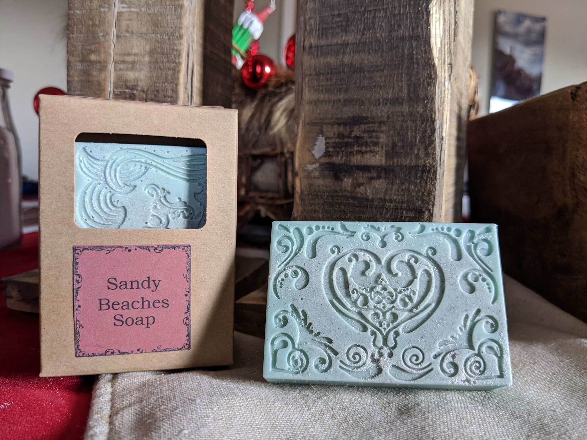 Sandy Beaches Soap - The Simply Good Sandy Beaches Goats Milk Soap is made using Lemongrass, Patchouli, Sweet Orange, Rosemary and Eucalyptus Essential Oils.  This soap also contains pumice throughout for that extra scrub.