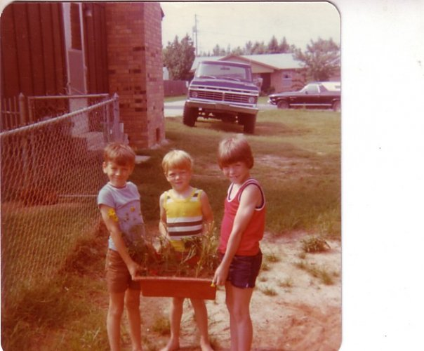 The side door to the new addition to our house. Circa 1977 with my brother Jeff and Steve Bunger.